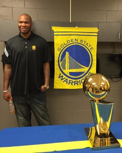 Marreese Speights chats with friends and family with the Larry O'Brien Trophy on display at a reception today in St. Petersburg, Florida. CHUCK MYRON/Hoops Rumors