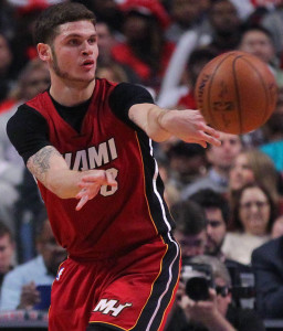 Jan 25, 2016; Chicago, IL, USA; Miami Heat guard Tyler Johnson (8) passes around Chicago Bulls guard Aaron Brooks (0) during the second quarter at the United Center. Mandatory Credit: Dennis Wierzbicki-USA TODAY Sports